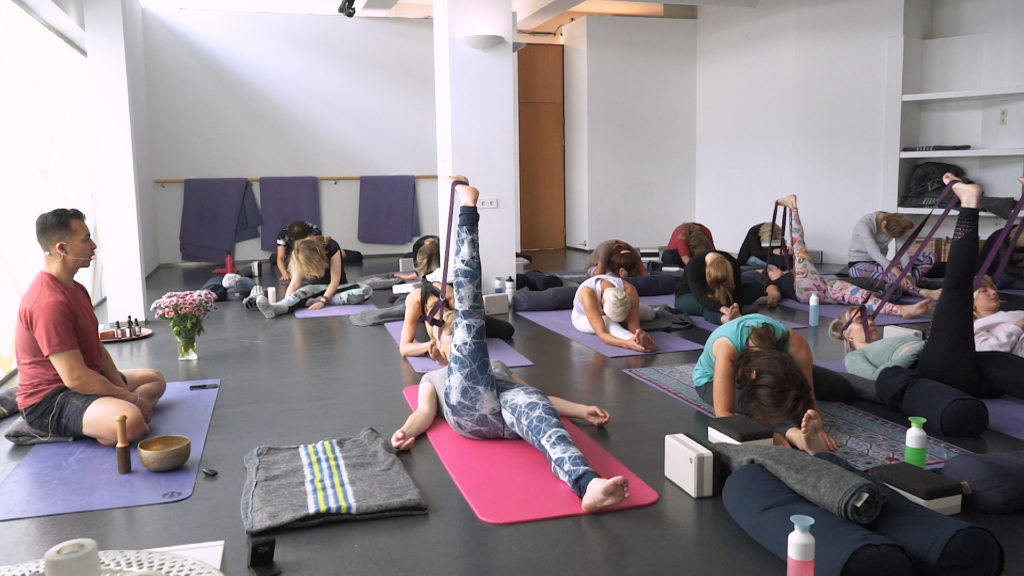 TFY Marcel giving a yin class in Moon Yoga Club in Bergen